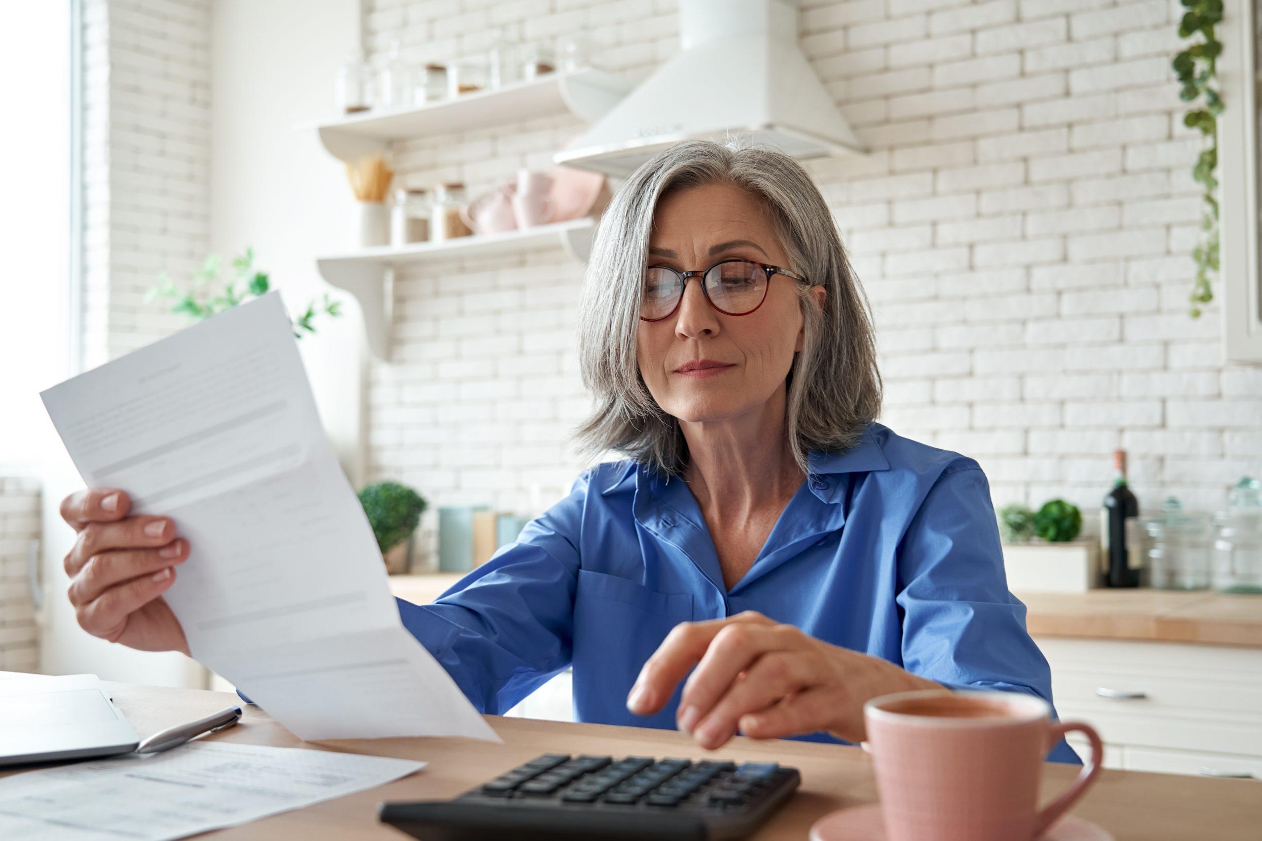woman looking at Medicare bill